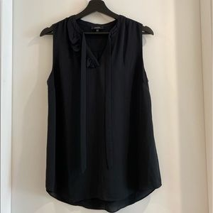 Black tank top blouse with ruffles and bow on neck